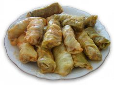 Sarmale (Romanian cabbage rolls) - a tasty meal you can prepare yourself! Recipe and video on site  These are a Turkish dish, too. Must visit Romania to see if they taste the same.