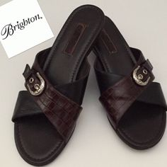 "Brighton Lorna Brown & Black Leather Sandals🔴Sale New without a box, Authentic Brighton Lorna Sandals. Slip on your leather sandals by Brighton for a classy finish to your outfit,""Etched Brighton Buckle"" Lightly cushioned footbed. Stacked wedge heel, Heel height 1 1/4""  medium width. Size 8. Brighton Shoes Sandals"