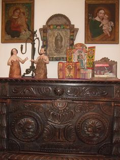 Mexican religious art pieces on a beautiful carved chest