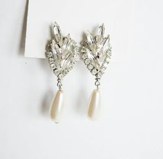Check out this item in my Etsy shop https://www.etsy.com/listing/251642547/vintage-bridal-earrings-vintage-style