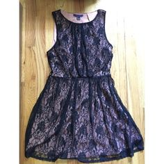 Black Lace Dress Only wore this dress once for a school dance! It has two layers, the outer is black lace and the inner is a nude layer. Very cute. Size large but could fit a medium as well. Forever 21 Dresses Midi
