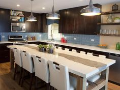 A large kitchen island can provide more room for seating, food preparation or cooking.