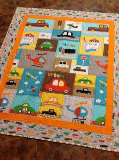 Baby boy crib quilt -- Vroom 2 -- cars, trucks, blue, brown, yellow, orange. $135.00, via Etsy.