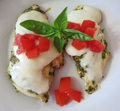 Cheesy Pesto Chicken - Tender chicken marinated in fresh pesto covered in gooey mozzarella cheese and topped with fresh tomatoes.