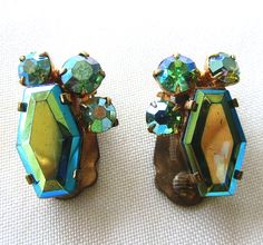 Beautiful pair of vintage gold tone earrings with green AB rhinestones.They measure 3/4 x 1/2 each.Good condition....  #aurora borealis #blue #clip-on #green