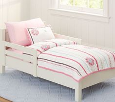 I like this quilt for Isla's toddler bed.  Petite Paisley Toddler Bedding | Pottery Barn Kids