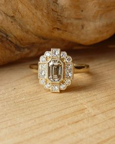 Emerald Cut white saphiree and Diamond Halo Ring Deposit by kateszabone on Etsy Canadian store Diamond Wedding Rings, Halo Diamond, Diamond Rings, Art Deco Diamond, Wedding Bands, Elizabeth Diamond Company, Bling, Emerald Cut Diamonds, Ring Verlobung