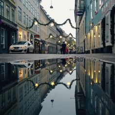 Photographer Captures Beautiful Reflections Of Copenhagen In Rainy Day Puddles - DesignTAXI.com