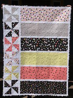 Quick, easy, and fun quilt to ake in one day! Simple pinwheel blocks and large strips are perfect. Pieced Brain: Quilts in one Day