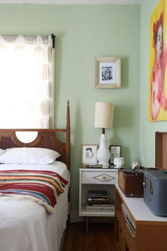 Adam's Eclectic Vintage Bungalow. Such cute vintage furniture in this cozy bedroom painted a lovely mint green.