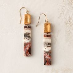 "Rectangles of galaxy jasper pair with organic gold to form these unusual drop earrings, each pair designed and hand-crafted in Atlanta by mother-daughter team Avindy.- Galaxy jasper, organic gold, 14k gold fill ear wire- Handmade in the USA0.4""W, 2.5""L"