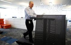 """A new Biogen complex in Cambridge  features """"walk stations"""" where employees can work while walking on treadmills."""
