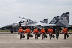Indonesian Air Force Sukhoi fighter pilots and crew walk across the tarmac after training for an upcoming military exercise at Hang Nadim Airport, Batam, Riau Islands, Indonesia October 2016 in this photo taken by Antara Foto. Picture taken October Jet Fighter Pilot, Fighter Jets, Military Jets, Military Aircraft, Russian Jet, West Papua, Air Charter, Sukhoi, Military Photos