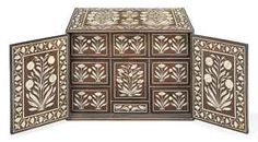 AN ANGLO-INDIAN IVORY-INLAID HARDWOOD TABLE CABINET