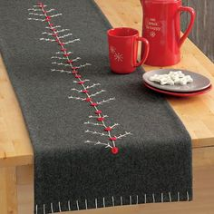 Natural Wool Felt Chalet Tree Table Runner is hand-embroidered, hand-cut and hand-sewn from natural wool felt.