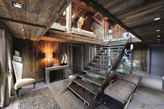 Glass-framed staircase leads to a living area in this chalet located in the Rhône-Alpes region in France.[1800  1200]