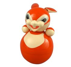 """5.5"""" painted plastic """"roly-poly"""" musical character rabbit toy, Soviet Union, 1965, maker unknown."""