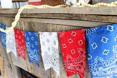 Make this patriotic DIY bandana banner to add a little Americana to your home this summer. It's so easy with no sewing required!