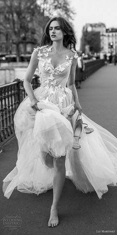 liz martinez 2018 bridal sleeveless v neck ruched bodice lightly embellished bodice tulle skirt romantic a line wedding dress open back chapel train (1) mv