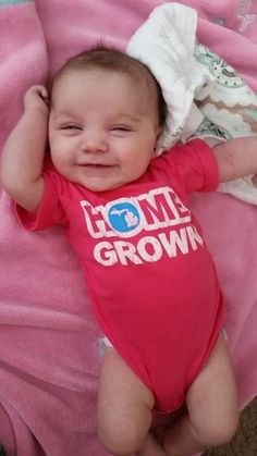 How cute is this little girl! Check out our Michigan Home Grown onesies here......
