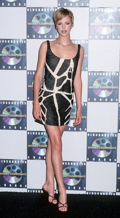 Charlize-showed-off-her-mile-long-legs-fitted-minidress-min