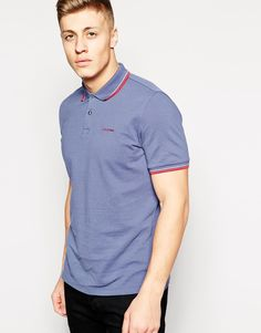 """Polo shirt by Ben Sherman Breathable cotton pique Polo collar with twin tipping Two button fastening Ribbed cuffs Logo to chest Regular fit - true to size Machine wash 100% Cotton Our model wears a size Medium and is 187cm/6'1.5"""" tall"""