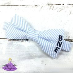 This seersucker bow tie will look fabulous in photos and on special occasions! It is the perfect personalized gift for all the guys in your life! It can be made to fit newborns, babies, toddlers, and little boys. It is a special, yet comfortable accessory for both everyday and special occasions. Your men will stand out from the crowd in these monogrammed bow ties.  The bow tie is made to order especially for you in the colors you choose. Currently available in white, blue, aqua, navy, brown…