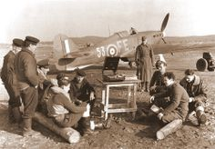 RAF Pilots of 81 Squadron sit around playing cards and listening to a gramophone in Murmansk Soviet Union