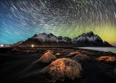 """After a not really great sunset without any cloud I was hoping that at least the night could be without cloud as well and Stokksnes made me this gift for one hour. A faint northen lights shown at the horizon and for the foreground a car decided to turn back on my spot and light up the dunes"" - ViewBug community member alessioputzu #icelandlandscapes #nightscapes #longexposure #viewbug by viewbug"