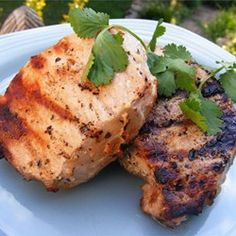 "Grilled Lemon Herb Pork Chops | ""Fabulous! The flavor was excellent, but not overpowering. Even our 5 year old cleaned her plate! """