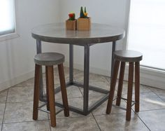 Hand-crafted concrete table top with welded steel by MeadowsLTD
