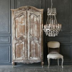 Charming Eloquence antique French armoire with four shelves and arched top. This armoire id delicately carved with a floral design. Functional doors and key