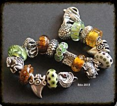 Dragons and spells What a beauty! Another fabulous dragon themed bracelet. By Deborah Taylor