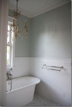 Erika @ Urban Grace Interiors uses a simple, clean subway tile, but also uses a decorative border at the top. Via decorpad. I'm a fan of contrasting the crisp whiteness of the subway tile with a pretty paint color on the wall.