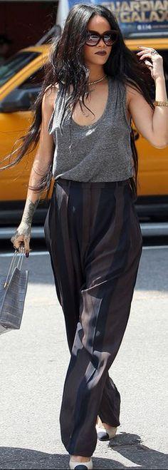 Rihanna: Purse – Balenciaga Shirt – Alexander Wang Pants – Haider Ackermann Sunglasses – Italia Independent Shoes – Chanel