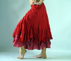 Color - Bold red, rose underskirt.   These beautiful skirts are 100% lightweight cotton. The two layers are raggedly cut to produce a great Gypsy
