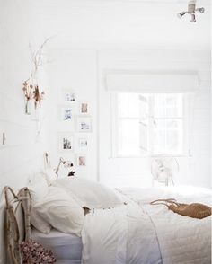 white boho interior. Love the floaty feel! I just want to sink into that beautiful bed.