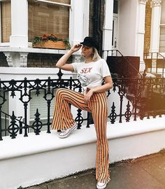 Get this look: http://lb.nu/look/8805331  More looks by Dominique Malinowska: http://lb.nu/dmalinowska  Items in this look:  Pretty Little Thing Striped Flares, Yellow Aviator Sunglasses, Baker Boy Hat, The Lovers And Drifters Club Sex The Breakfast Of Champions Tee   #artistic #bohemian #retro