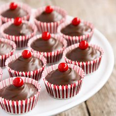 I had so much fun creating these Chocolate Cherry Candy Cups! They incorporate so many of my favorite things… I ♥ chocolate and cherry together…it's always been a favorite combination of mine. These recipes are treasures:  Chocolate Covered Cherry Cookies and Chocolate Cherry Fudge Bundt. These sweet candy cups are topped with red Sixlets candies. …