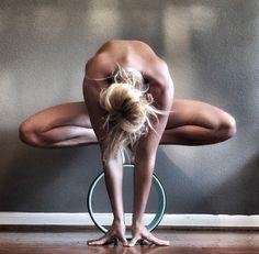yoga pose on dharma wheel.
