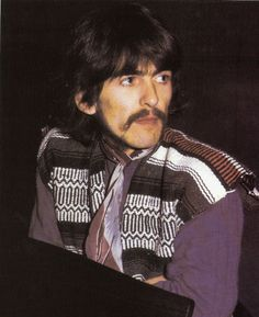 George Harrison during a Sgt. Pepper's Lonely Hearts Club Band recording session.