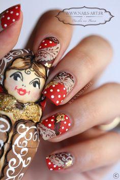 A matryoshka doll nail art (aka Russian nesting/nested doll); cool that it looks like fabric.