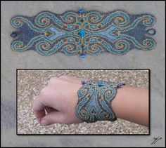 """(2005 - 2011) 9""""x 3"""", Size 11 delica beads (matte black, matte grey iris, blue and gold iris silver metallic), push buttons, polyester thread. I threaded this bracelet as a seamless cuff several ye..."""