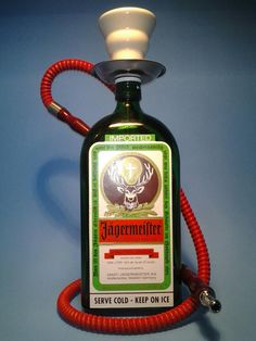 ( Jagermeister ) One Man Hookah  Red w/ 1 Hose  Hookah – Shisha Made From Recycled Liquor Bottle ( Jagermeister )  This is a Quality Handmade Hookah – Shisha  Recycled and Handmade from bottles saved by local restaurants, bars and local area shops. We re-purpose these bottles by taking our time and turning them into great looking Hookahs for you and your friends to enjoy.