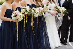 Navy Bridesmaids Dresses, bouquets by Fleur Inc | photography by http://www.sarahpostma.com