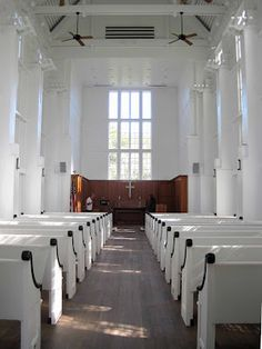 Non-denominational chapel in Seaside, FL was designed by Scott Merrill of Merrill and Pastor Architects (love their work). Note the old fashioned pews and the paneled Apse or Altar front. Tall ceilings and fans help in the hot summer weather.
