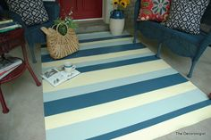 This 'floor cloth' from a painted vinyl remnant is on a front porch.