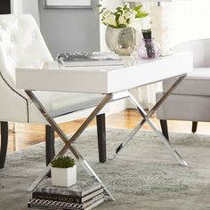 Features:  -Modern, high gloss finish.  -Sturdy yet stylish silver metal legs.  Desk Type: -Writing desk.  Top Finish: -White.  Base Finish: -Chrome.  Accent Finish: -Chrome legs.  Top Material: -Wood