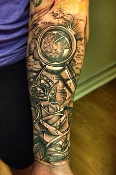 Map With Magnifying Glass And Rose Tattoo On Forearm