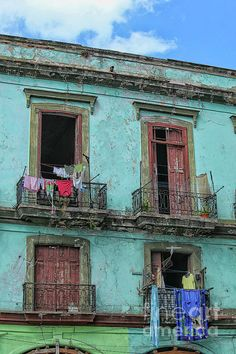 Laundry hanging from old houses in Cuba by Patricia Hofmeester Cuba Photography, Framed Art Prints, Canvas Prints, New Orleans Art, Spiral Notebooks, Phone Covers, Central America, Shutters, Wood Print